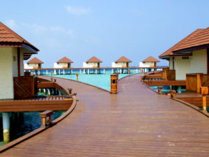 Alimatha Aquatic Resort water bungalows with jetty
