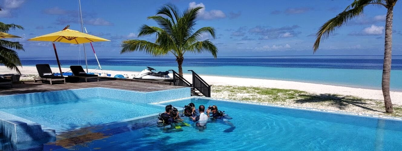 Learning how to dive at the Outrigger Konotta Maldives Resort pool; offshore coral fans, Outrigger Konotta Maldives Resort