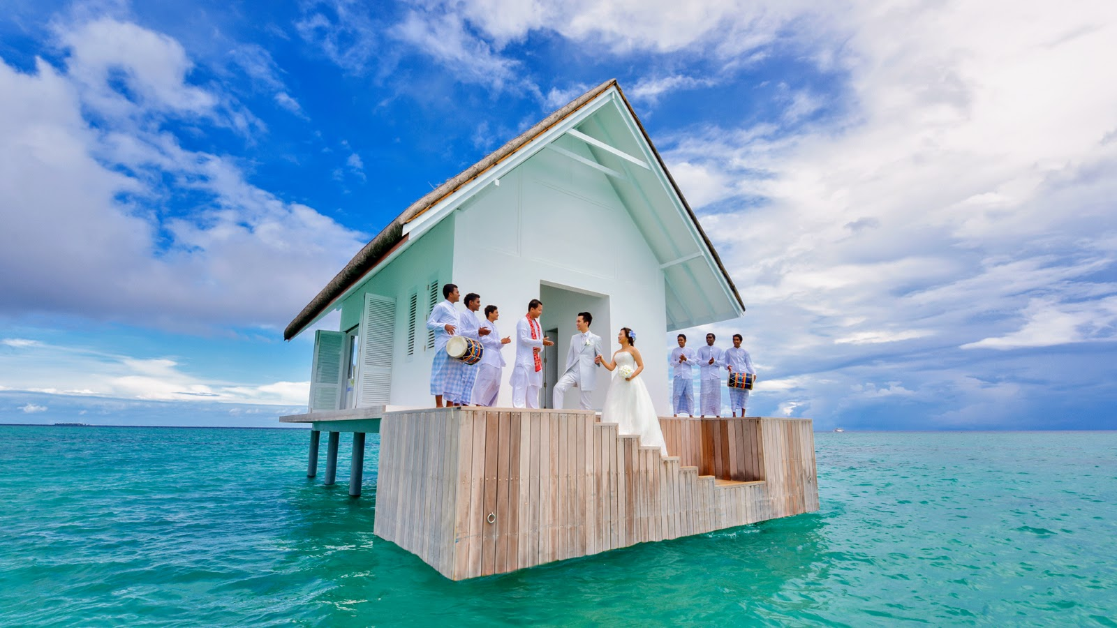An Overwater Wedding Pavilion afloat in the UNESCO Biosphere Preserve, Four Seasons Resort Maldives at Landaa Giraavaru