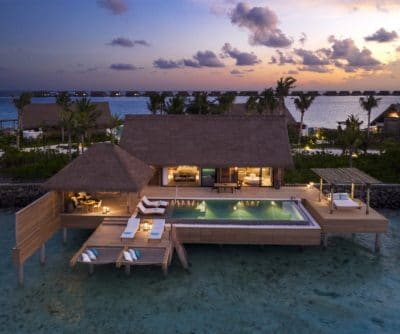 An Aerial Sunset Photo of The Reef Villa with Pool