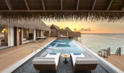 Reef & Overwater Villa's Sundeck With Pool at Dusk